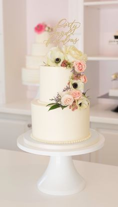 Buttercream cake with anenomies and spring flowers