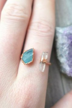 A deep pool of rough apatite against organic copper accompanied with a lavender raw scapolite gem in this open copper band. See new sizes that are Ready to Ship! Ready to Ship items ship out within 1-