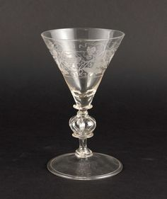 Goblet, The Netherlands, 17 Century, round, slightly curved inwards as with inverted rim, baluster shaft with hollow glass structure, funnel-shaped bowl, clear glass, cup with circular cut decoration, vines and foliage, H. 17.5 cm