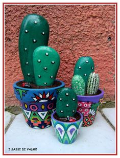 painted rock cacti in painted pots - nice presentation. Finally a plant I can't kill lol