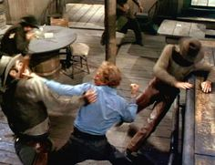 Shane (Alan Ladd) kicks Chris Calloway's (Ben Johnson) ass in the bar fight scene and then he and Starret (Van Helfin) clean house.  Great fist fight scene.