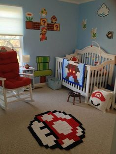 Super Mario Bros themed baby nursery - Mario blanket, mushroom rug, goomba stool, Mario mobile, and more.