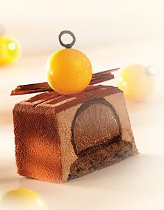 Choc. Sponge Cake, the base for a chocolate log. Melt 390 g choc. with 145 g butter. Whip 285 g egg yolks with 166 g sugar and fold in the choc. Whip 330 g whites with 166 g sugar and fold in the mixture. Bake in two baking sheets at 190 C for 8 min. Other components of the log: CRÉMEUX MADAGASCAR (choc. insert) and CHOCOLATE BAVAROIS.