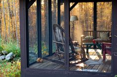 For the screened porch - Love the lamp, rugs, bent willow rocker... Just need a cup of coffee!