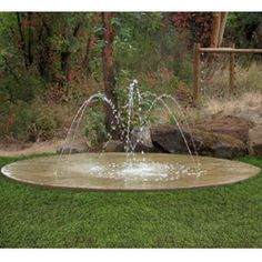splash pad-- again not soft-- but has the look of our yard to be