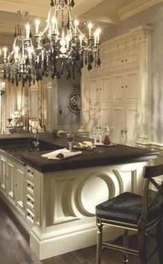 chandeliers like these in what I can only presume to be the kitchen...makes me nostalgic for the days of aristocracy