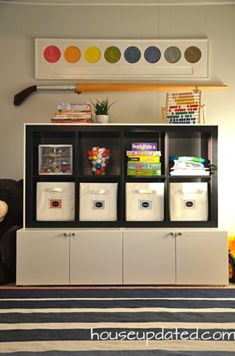 DIY Playroom Storage [Pottery Barn Kids Cameron Storage knock-off for a fraction of the price!]:  use an expedit + ikea kitchen cabinets to create a two-tone storage look for all your organizing needs