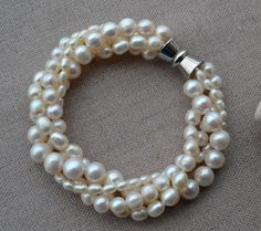 Pearl Bracelet, 3-9mm 4 rows 7 inches freshwater pearl Bracelets,ivory pearl Bracelets,free shipping. $13.50, via Etsy.