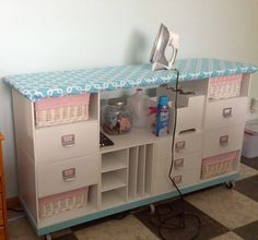 An ironing center out of Scrapbook cubes. Would be a great use of an old dresser - just add casters.