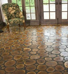 LOG END FLOORING: use the trees from ones own property to add to the narrative of the building.