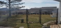 Black vinyl coated chain link fence installed by Ryan, Skip & Ray for this home in Northampton Fence Styles, Chain Link Fence, Wood, Black, Wire Fence, Chicken Wire, Woodwind Instrument, Black People, Timber Wood