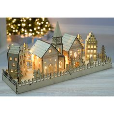 WeRChristmas 45 cm Pre-Lit Wooden Large 4 House Village Scene with Church Christmas Decoration Illuminated with Warm White LED Lights: Amazon.co.uk: Kitchen & Home