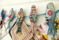 scrappy birds on clothes pegs