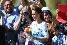 BRISBANE, AUSTRALIA - APRIL 19:  Catherine, Duchess of Cambridge departs a function holding flowers at the Royal Australian Airforce Base at Amberley on April 19, 2014 in Brisbane, Australia. The Duke and Duchess of Cambridge are on a three-week tour of Australia and New Zealand, the first official trip overseas with their son, Prince George of Cambridge.  (Photo by Chris Hyde/Getty Images)