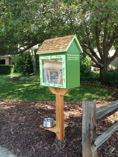 "Pamela Brewer. Fort Collins, CO. Our home that has a path next to it. Unfortunately our beagle Molly seems to resist the idea that she shouldn't bark EVERY time someone with a dog walks by. We created our Little Library in honor of our beagle Molly. We painted it with paws on the front, keep it stocked with dog biscuits for neighborhood canines and have a fresh bowl of water at the base. It's our way of saying ""sorry for the annoying beagle barking at you"" but here's a bit of neighborly thanks."
