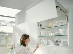 After installing your AVENTOS lift system, simply attach the SERVO-DRIVE for AVENTOS components to the lift mechanism and cabinet. New Zealand English, Cleaning Cabinets, Provinces Of China, English China, Cabinet Doors, Bathroom Medicine Cabinet, Kitchen Corner, Kitchen Hardware, Fonts