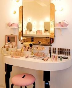 Round Vanity setup with gold framed mirror.