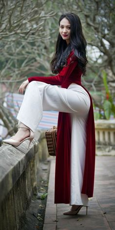 Sexy Young Asian Girl Wearing a Red Velvet Vietnamese National Outfit Áo dài Over Loose White Pants and High Heels. Vietnamese Traditional Dress, Traditional Dresses, Beautiful Asian Women, Beautiful Beautiful, Sexy Asian Girls, Fashion Week, Asian Fashion, Asian Woman, Asian Beauty