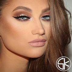 The Nude look is a hott makeup look - give it some pop with well defined cat eye.