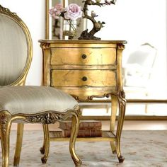 ROCOCO BEDSIDE This elegant, handmade carved wood bedside is finished in gold leaf and has a pretty rattan shelf.