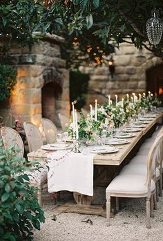 Elevate your backyard with elegant white table runners, lush centerpieces and romantic candelabras. It's also important to stick to a crisp, neutral color palette to create the illusion of a bigger and brighter space.