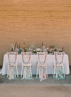 pretty chairs - photo by www.kissthegroom.com Love the ribbon!