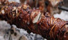 GREECE: Most commonly only eaten during Orthodox Easter celebrations, kokoretsi is lamb or goat intestines wrapped around organ meats and usually grilled. Easter Celebration, Easter Recipes, Easter Ideas, Meatloaf, Lamb, Grilling, Pork, Yummy Food, Beef