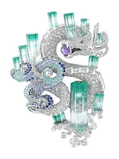 A diamond, sapphire and aquamarine Van Cleef & Arpels brooch in the form of an Oriental dragon with a flaming pearl in its mouth.