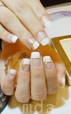White french manicure with golden Christmas nail art