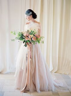 The bride in all her glory. Blush dress by Carol Hannah, flowers by Sarah Winward.