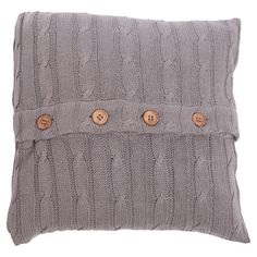 Showcasing a cable knit cotton design and button closure, this lovely pillow adds a touch of cottage-inspired charm to your sofa or settee.