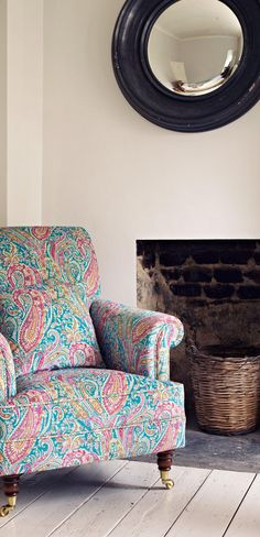 The upholstery fabric by Liberty Art is as colourful as it is complex in pattern. The castors add an American flair. The very modern mirror contrasts the texture of the woven basket. The style is still cohesive, as all the items are of the same quality.