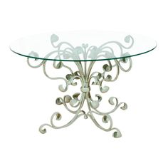 Fabulous iron patio table, Italian, of course.  I think a nice lunch would look gorgeous on it...