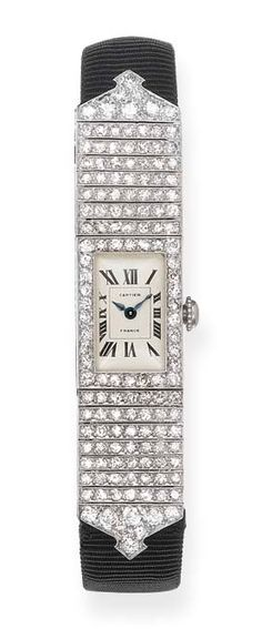 A LADY'S ART DECO DIAMOND WRISTWATCH, BY CARTIER  The rectangular cream dial with Roman numerals and blued steel hands to the diamond-set surround and articulated shoulders, later black silk strap, watch circa 1925, with French assay marks for platinum Dial signed Cartier, reverse Nos. 23356 & 29686, with maker's mark EJ for Edmond Jaeger