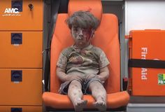 A child sitting in an ambulance after his home was destroyed by an air strike in Aleppo, Syria, August 2016.  Found on https://www.britannica.com/event/Syrian-Civil-War/Civil-war