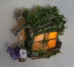 Fairy Window with Basket of Flowers and Light Garden Fairy Window Handcrafted by Olive ~ always one of a kind Fairy Window includes battery operated LED soft gold light ~ beautifully illuminates and can be used for indoor and outdoor use. Simply to install, one small brass nail