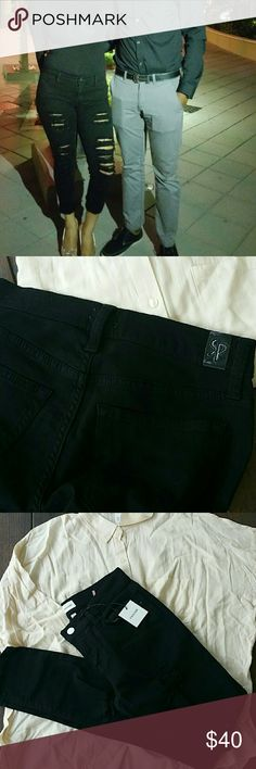 Skinny ripped black  denim jeans The quality is amazing,  true to size, soft like gloves.  Model wearing size 3 Pants Skinny