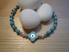 Handmade Turquoise Evil Eye Protection Charm Bracelet with Mother of Pearls by urbaneprincess on Etsy