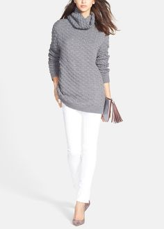 Chunky, textured sweaters are a wardrobe staple for winter chic looks.