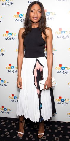 Naomie Harris hit the Croatia 'Full of Life' party in a sweet Issa design featuring a solid black bodice and a white-and-black floral-motif pleated skirt. A white envelope clutch and ankle-strap sandals completed her look.