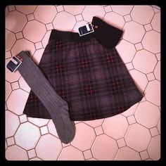 """SALE! Sexy Plaid Skirt Bundle  NWOT Sexy Plaid """"school girl"""" inspired skirt in grey, black, & red plaid that hits a little bit above the knee. (On me, and, I'm 5' 6"""" approx). Has an elastic waist band and is 95% Polyester 5% Spandex. Sz X-L in Juniors. Versatility in size due to the elastic waist.. Fits up to Wms Md. Includes 2 pair Knee High Socks (NWT) in solid colors: 1 Grey & 1 black. Super sassy w/2 buttons at top of socks for decor. All in perfect condition. Fun to play dress up…"""