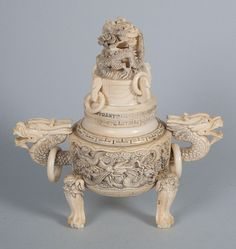 Chinese carved ivory censer tripod form with dragon handles, lid knop, and dragon relief decoration, 8 in. H., 7 1/2 in.