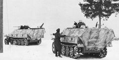 Ausf D variants of a SdKfz 251/10 and a SdKfz 251/1 traveling in winter conditions providing reconnaissance duty