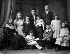 The sizable Maloney family of Newtown, Waterford, Ireland, February 1906 (the baby in the middle is so precious - like a living doll). #vintage #Edwardian #portrait #1900s