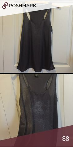 WET SEAL Metallic Sparkle Charcoal Gray Tank Top Metallic / sparkle charcoal gray tank top from Wet Seal. Racerback. Semi loose fit. Looks great paired with a leather motorcycle jacket! Could easily fit as a S as well. Worn but looks brand new. 100% polyester. Wet Seal Tops Tank Tops