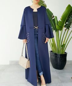 Navy blue neoprene abaya with gold metal detailing , pockets. Www.qabeela.biz