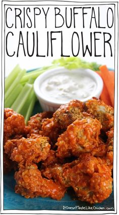 Crispy Buffalo Cauliflower! Spiced corn flake coated florets are baked making these an easy healthy alternative to chicken wings. Great appetizer for the Super Bowl or any bar night. Vegan, vegetarian, gluten free. #itdoesnttastelikechicken