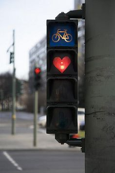 Where is this?  Do they actually use red hearts on their signs instead of round stop signs???  Love this!