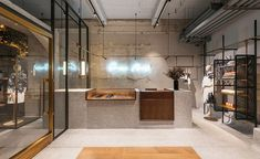 Comme Moi's industrial flagship store with bare concrete walls and terrazzo floors