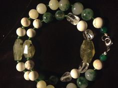 Gorgeous,earthy green agate and natural mixed stone necklace,that falls at collar bone.White howlite,clear quartz crystals,and translucent chunky moss
